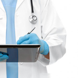Healthcare Doctor Writing on Tablet