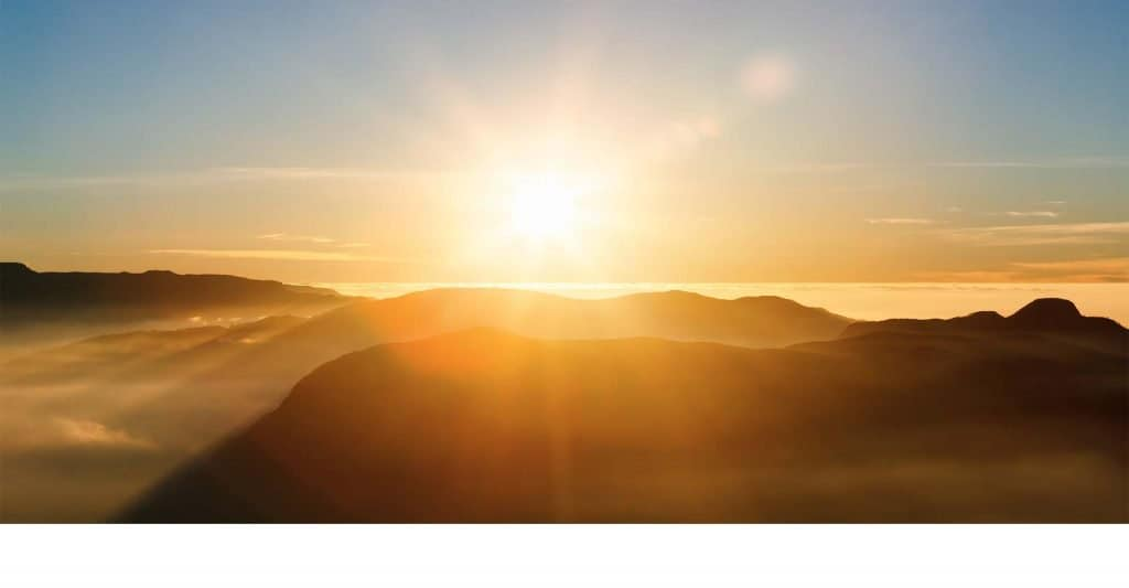 mountain landscape with sun rising in background