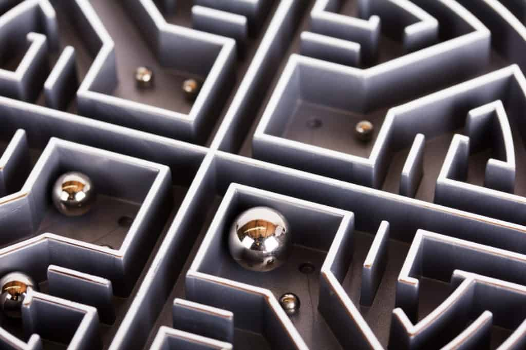 Close up of a grey labyrinth or maze puzzle