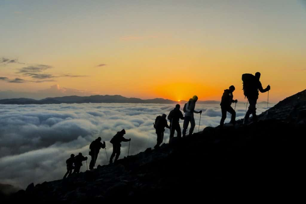 website16_about_us_hikers_clouds_iStock_71143375_1440x