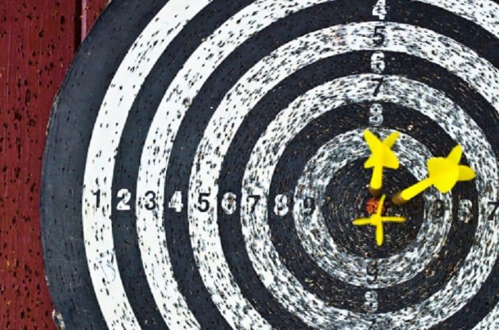 bullseye with yellow darts