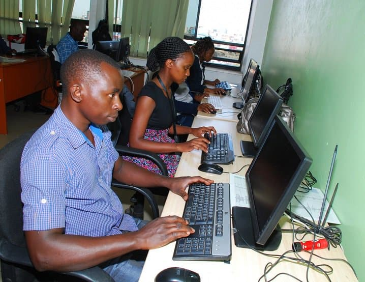 two african workers on their desktop keyboards