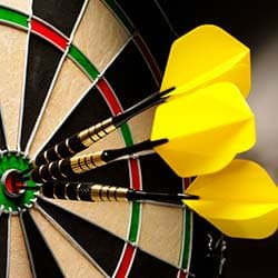 yellow darts in dart board