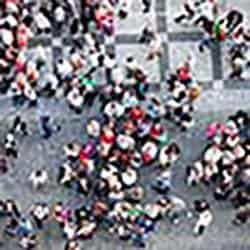 crowd of people walking in street
