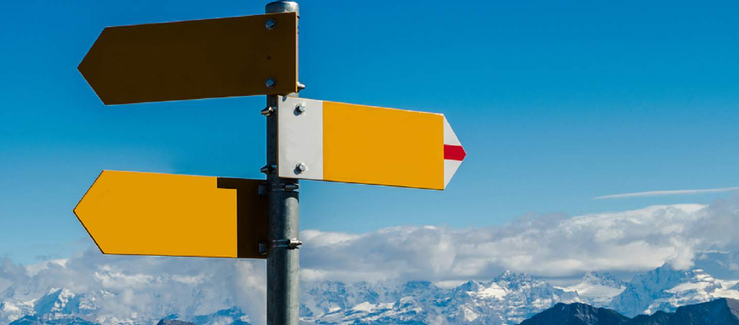 Crossroad signpost in swiss alps