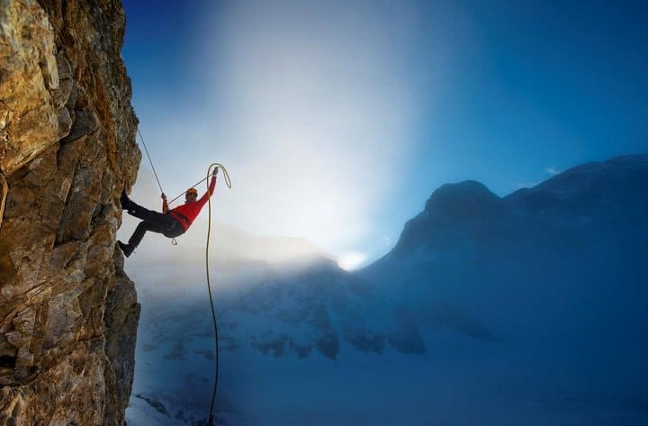 mountain climber on a vertical mountain slope