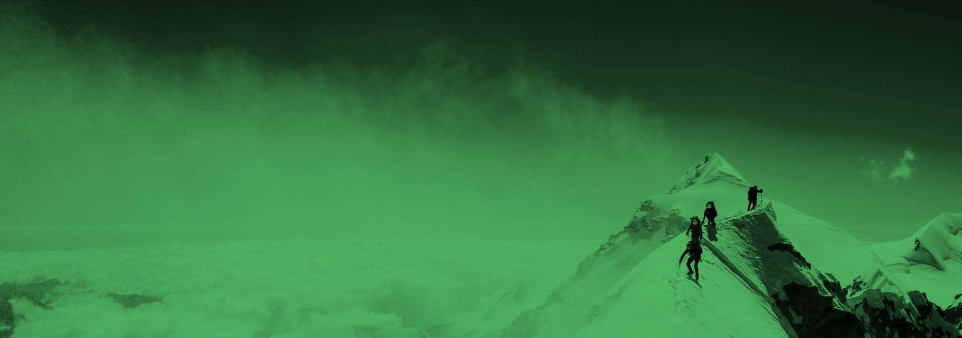 snow-covered mountain with climbers near top with green overlay on image