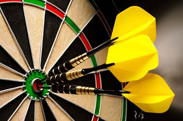 dart board with yellow darts on bullseye