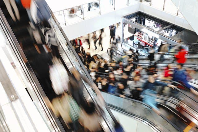 rush of people going up and down escalators