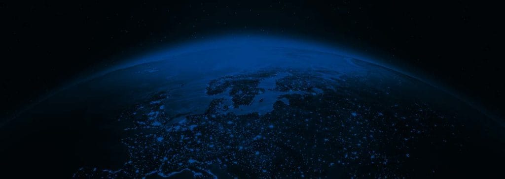 View of earth at night from above with dark blue overlay